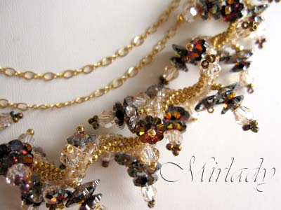 Medal winning 3 strand necklace made with Swarovski beads and gold filled findings. Classy Autumn colors